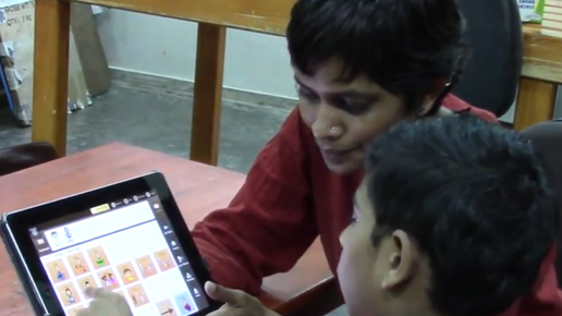 Child and Therapist using Avaz App in therapy
